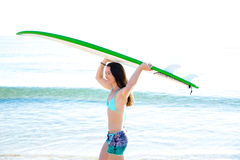 Surf girl with surfboard in beach shore. Surf beautiful girl with green surfboard in beach shore Royalty Free Stock Photo