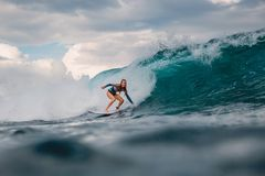 Surf girl on surfboard. Surfer woman and blue wave royalty free stock images