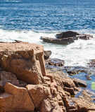 Surf Hitting Brown Boulders Stock Images