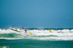 Surf Ironman Series. GOLD COST, SURFERS PARADISE, QLD, AUSTRALIA - February 2013: Two athlete compete in the kayaking stage on the round four of the Surf stock photography