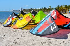 Surf kites waiting for riders Stock Photos