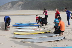 Surf lessons in portugal. Placing the leach Royalty Free Stock Photo
