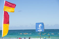 Surf life saving flags Australian beach Royalty Free Stock Photo