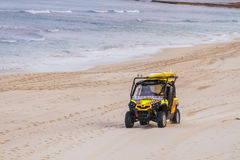 Surf Lifeguard vehicle driving on a beach Royalty Free Stock Images