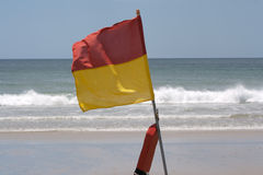 A surf lifesaving flag Royalty Free Stock Photography