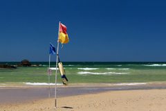 Surf lifesaving flag on beach. Stock Photos