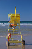 Surf Patrol Tower. A Surf Life Saver watching the sea and the bathers from his yellow patrol tower on a beach, Australia. These volunteers are a common feature Royalty Free Stock Photo