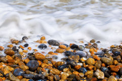 Surf and pebbles Royalty Free Stock Image