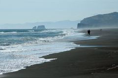 Surf.People.Sand. Very big beach. Pacific ocean, east coast of peninsula Kamchatcka Stock Photo