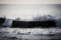 Surf on the pier. Atlantic Ocean Stock Image