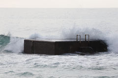 Surf on the pier. Atlantic Ocean. Royalty Free Stock Photo