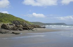 Portholland Beach and St. Austell Bay, Cornwall. Surf at Portholland Beach and View of St. Austell Bay, Cornwall Stock Image