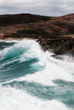 Surf pounding Aruba's rocky coast Royalty Free Stock Images