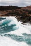 Surf pounding Aruba's rocky coast. Heavy seas pound the north coast of Aruba Royalty Free Stock Images