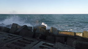 Surf and Rainbow at the Breakwater stock footage