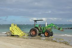 Surf rake on tractor by sea Stock Image