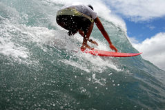 Surf ready for a tube ride. A shortboarder getting ready for a tube ride in hawaii's clear water stock images