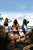 Surf report. Teenage girls checking out the (guys)SURF Royalty Free Stock Images