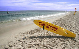Surf rescue. Beach in Australia with a surfboard for the lifeguards Stock Photos