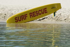 Surf Rescue. A bright yellow surfboard, standing by for use by surf rescue Royalty Free Stock Images