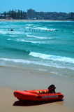 Surf rescue. Red boat with white sign: surf rescue, blue ocean in background Royalty Free Stock Image