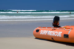 Surf rescue. Beach scene with surf rescue boat royalty free stock photo