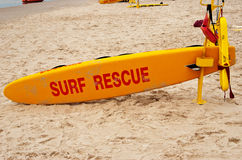 Surf rescue board on a white sand beach Royalty Free Stock Image