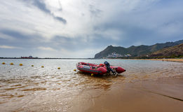 Surf Rescue boat at coast of Teresitas beach on Tenerife island, Spain Royalty Free Stock Photo