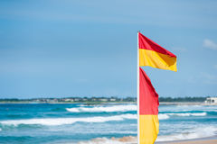 Surf rescue flags Stock Photos