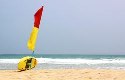 Surf Rescue surfboard and flags Stock Photo