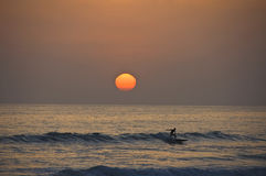 Surf Ride and sunset. Stock Photo