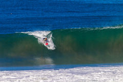Surfer Catching Hollow Wave Stock Photography