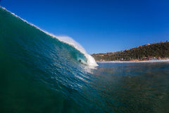 Surf Rider Distant Big Hollow Wave Stock Photos