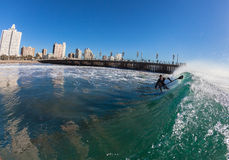 Surf Rider SUP Riding Wave Durban Royalty Free Stock Photography