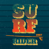 Surf rider. Typography with surfboard. Vector print on t-shirt Royalty Free Stock Images