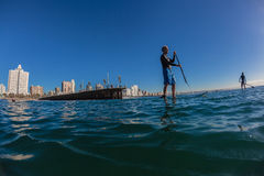 Surf Riders SUP Standing Morning Blue Stock Photography
