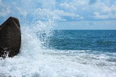 Surf and rock Royalty Free Stock Image