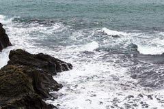 surf on rock coast of Atlantic ocean in Iceland Royalty Free Stock Photos
