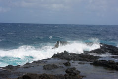 Surf on the Rocks - Kauai, Hawaiian Islands Stock Photography