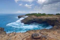 Surf on the rocks near the island of Lembongan Bali Royalty Free Stock Photo