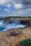 Surf in the rocks near the island of Lembongan Bali Stock Photo