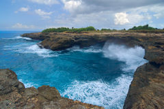 Surf on the rocks near the island of Lembongan Stock Photography