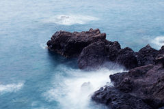 Surf and rocks in  sea Stock Image