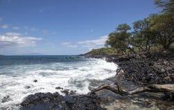 Surf, Rocks, Waves. Surf and waves crashing on the rocks of Maui, Hawaii stock images