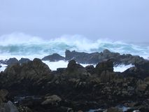 Surf on rocky beach, Pacific Grove, California stock photography