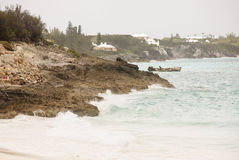 Surf on Rocky Coast of Bermuda. Surf on the rocky coast of Bermuda on cloudy day Royalty Free Stock Photo