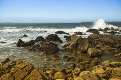 Surf at rocky ocean coast. Atlantic ocean Royalty Free Stock Photos