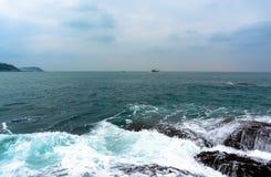 Surf on the rocky shore. Of the Andaman sea Thailand Phuket Royalty Free Stock Photo