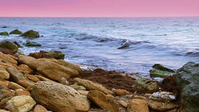 Surf on the Rocky Shore. Slow Motion Stock Photography
