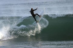Surf's Up. Surfer hits the crest of a wave head-on Stock Photography